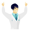 young asian doctor standing with raised arms up vector image vector image