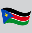 flag of south sudan waving on gray background vector image