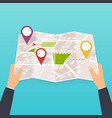 hand holding a paper map with points tourist look vector image vector image