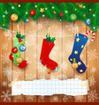 christmas socks and copy space on wooden vector image vector image