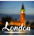 White calligraphy London sign on blurred photo vector image