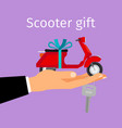 man hand holding gift scooter vector image vector image