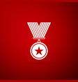 medal with star icon isolated on red background vector image vector image