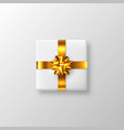 white gift box with golden bow and ribbon vector image vector image