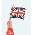 hand holds flag great britain vector image vector image