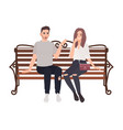 young couple sitting together on street bench
