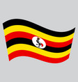 flag of uganda waving on gray background vector image vector image