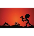 Silhouette of Halloween zombie and pumpkins vector image vector image