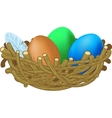 three colored eggs lie in a nest Easter vector image vector image