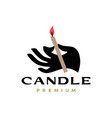 hand hold holding candle logo icon vector image