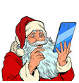 santa claus and a big smartphone electronic vector image vector image