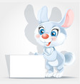 cute bunny holding banner in his paws vector image vector image