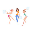 beautiful girls dressed in pajamas playing pillow vector image vector image