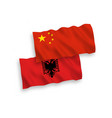 flags albania and china on a white background vector image