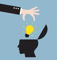 businessman hand put bright light bulb in human vector image vector image