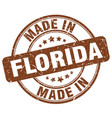 made in florida brown grunge round stamp vector image vector image