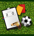 scoreboard soccer ball and whistle on green grass vector image vector image