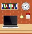 laptop on designer desktop in modern office vector image