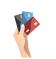 hand holding credit card in flat design style vector image vector image