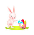 cute easter rabbit on green grass full wheelbarrow vector image vector image
