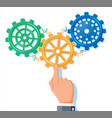 businessman hands joining three gears together vector image