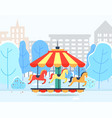 carousel in winter park with cityscape view vector image