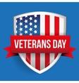 Veterans Day on USA flag shield vector image