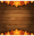 Border of autumn maples leaves on a wooden vector image