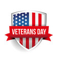 Veterans Day on USA flag shield vector image
