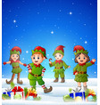 cartoon kids wearing elf costume in the winter bac vector image vector image