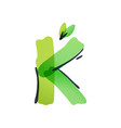 k letter ecology logo with green leaves