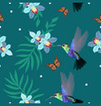 seamless pattern with hummingbirds orchids palm vector image