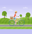 cheerful woman with flowers in the basket riding a vector image vector image