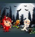 happy kids wearing halloween costume in the garden vector image vector image