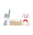 easter bunnies and easter eggs in wooden box for vector image