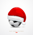 Santa hat on soccer ball vector image vector image