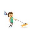 little boy walking with his naughty puppy vector image vector image