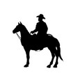 black silhouette of cowboy on horse vector image vector image