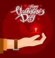 valentines day text with a precious gift in hand vector image vector image
