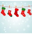 Christmas background with snowflakes and socks vector image