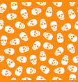 seamless pattern white skulls on a orange backgrou vector image