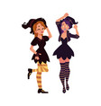 two girls women in pointed hats witch halloween