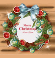 merry christmas wreath on wood background vector image