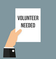 man showing paper volunteer needed text vector image
