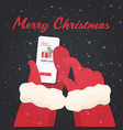 santa hands using mobile app rat with gift box vector image