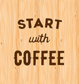 Hand written quote Start with coffee on wooden vector image vector image