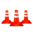 Three traffic cones on a white background vector image vector image