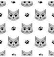 seamless pattern with cute cats and paw prints vector image vector image