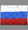 flag of russia painted on brickwall vector image vector image