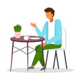 guy sits at round coffee table and drinks tea vector image vector image